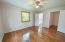 Hardwood flooring, ceiling fans, and newer windows in all bedrooms