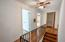 Hardwood flooring and freshly painted wrought iron upstairs railing..