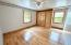 Hardwood flooring, ceiling fans, and newer windows in all bedrooms.