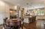 Custom cabinets, lighting and wood plank flooring.