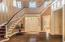 Beautiful foyer opens to a great room, dining room and kitchen.