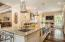 """State of the art kitchen with massive island 13'5"""" x 4'6"""" granite surface."""