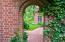 Brick side entrance to the backyard.
