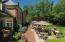 Three beautiful paver brick patios surrounded by perennial patios.