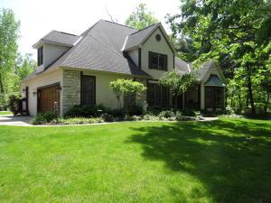 CUSTOM BUILT STONE & STUCCO 5/6 BEDROOM HOME, FINISHED BASEMENT, TWO 2-CAR GARAGES ON 1 1/2 AC LOT