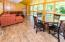 Large sunroom located off the kitchen to enjoy a morning cup of coffee. Deers walk right through the yard. Beautiful tiled flooring and recessed lighting also make this a nice evening spot to wind down.