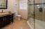 Modern decor in this full bath right off the Entertainment Room. Bath tub style shower.