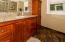 Off the hall is a full bath. Granite counters, modern faucets, tiled flooring.