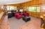 Acts as a loft with a look over to the Large Entertainment Room.