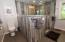 Just finished is a double shower with double shower heads. Walk through the headed area so no door is needed. You have to see this to believe it!
