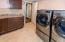 HUGE laundry room located in the Lower Level. Granite counters, updated flooring. Slop sink.
