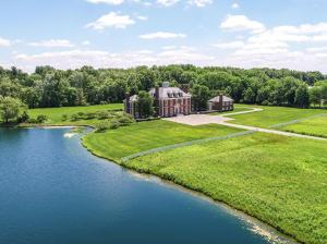 Stately Georgian Estate sited on 11 private acres in prestigious New Albany Farms.Grand formal rooms complement more casual living spaces.This 13,687sqft home consists of 6 BR,7 full&3half BA. Magnificent owner's retreat offers 2 luxurious baths & separate walk-in closets. There are 3BR suites on the 2nd flr & 2 BRs on the 3rd flr that are part of the main body of the house. A separate wing of the house has 2BR&1BA suite.The pool house w/private entrance has 1BR &1BA. Impeccably designed, rooms are oversized & elegant. Built to perfection w/custom cabinets, woodworking, crown molding & attention to every detail. Renovated in 2012, the chef's kit opens to both casual dining & family gathering rm.Elevator, theater, exquisite terraces, loggia, pool & 6-car garage create an idyllic retreat.