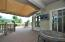 Electric extendable awning provides sun shade to watch the external TV