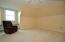 Fourth bedroom is wonderful space with window seat with storage space.