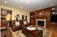 Wonderful detailed wood work defines this space with wet bar.