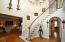 Spacious entry with grand staircase.