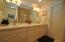 Dual sinks in this jack and Jill with plenty of storage and shower/tub.