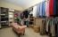 Amazing space and storage potential in this walk in closet.