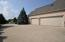 Three car garage with large parking pad for ease of in and out.