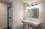 Bathroom 5 with vintage vanity and tile work.