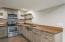 Lower level full kitchen with live edge honey locust wood countertops.