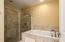 Shower for two with soak tub.