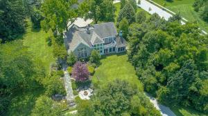 Stone & Hardiplank exterior, concrete drive with paver parking area, (2) basketball hoops/poles, mature treed lot, backs to walk path, gazebo & pond, firepit.