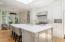 New marble countertops and ceramic backsplash.