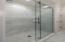 Renovated bathroom, new sliding door shower, custom vanity, marble flooring.