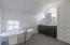 Carriage suite renovated bathroom, custom vanity, quartz countertops, DXV soaking tub.
