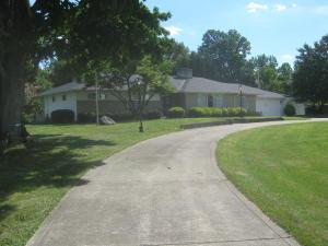Primary Front Photo: View of Home from the Left Side of the Circular Driveway