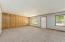 Spacious living room/family room with brand new carpeting.
