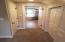 hallway between master bed and bath/extra closet space
