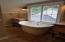 master bath/vessel soaking tub and dual sinks