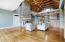 Custom details throughout including wood beam ceilings