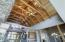 Wood beamed cathedral ceilings with ceiling fan