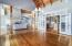 Expansive great room and dining with soft privacy french doors to kitchen