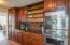 Expansive cabinetry and granite with stainless steel appliances are featured in the kitchen.