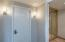 There is a large walk in closet, washer and dryer plus a steam shower.