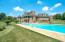 Professionally maintained pool with deck, outdoor shower, fireplace and gather areas