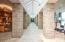 • Heated travertine flooring • Ivory painted walls • Atrium ceiling • Stone columns
