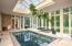 • Heated travertine flooring • Ivory painted walls • TV mount • Atrium skylights • Endless pool • Doors to patio • Door to Greenhouse