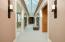 • Heated travertine and tan berber carpet flooring • Taupe and tan painted walls • Can lighting • Elevator shaft • Atrium ceiling • Wall sconces • Laundry chute