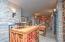 • Travertine flooring • Stone walls • Lighted wall sconces • (2) Open cedar closets • Cooler unit