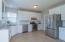 Large eat-in kitchen with NEW cabinets, granite countertops, tile backsplash, stainless steel appliances and ceramic tile floors!