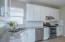 Granite countertops with tile backsplash!