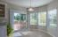 Ample amounts of natural light with bay window and sliding glass doors.