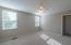 Features ceiling fan/light combo with walk-in closet.
