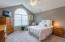 Large master suite with palladian window provides amble amounts of natural light!