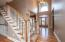 • Hardwood flooring • Tan painted walls • Two story ceiling • Leaded glass front door and sidelights • Hanging chandelier • Coat closet